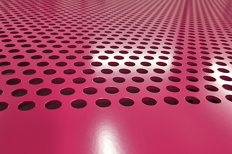 Router cut holes forming a perforated aluminium sheet