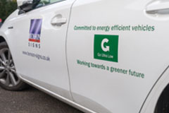 Hybrid Vehicle At Benson Signs